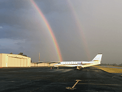 Airport runway with rainbow