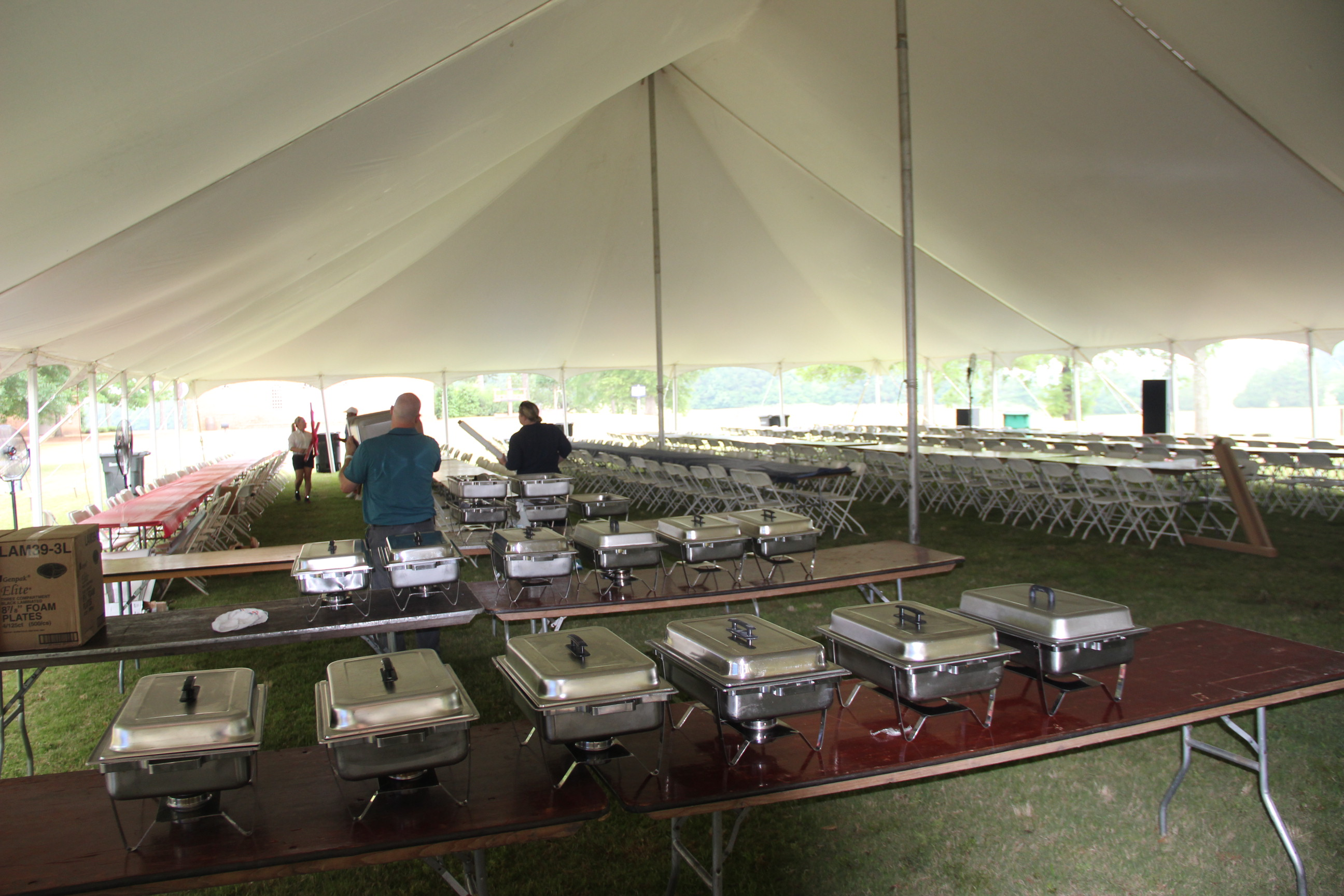 Image of food being set up under the tent