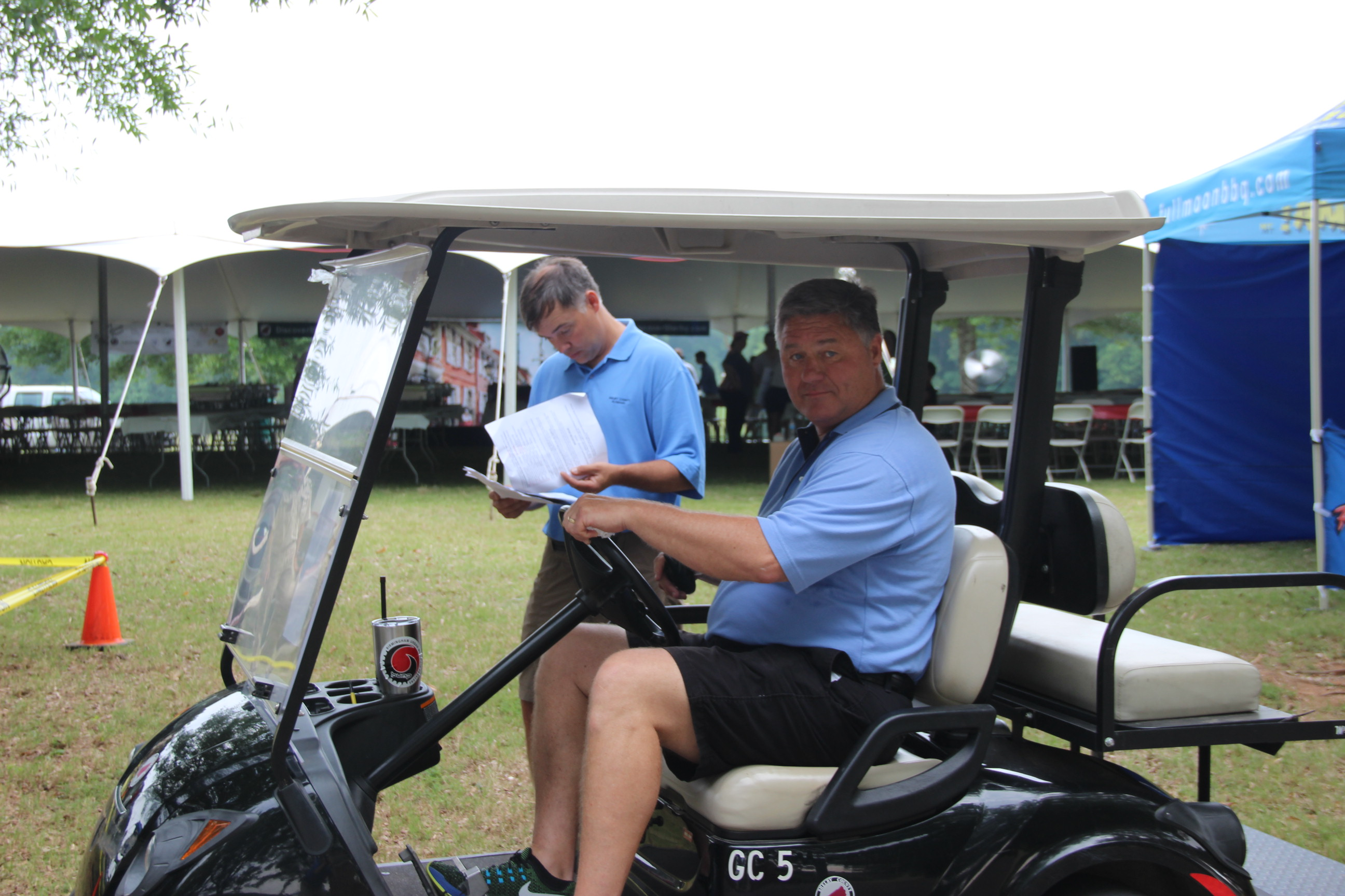 Image of the County Manager Alex Dudchock in golf cart