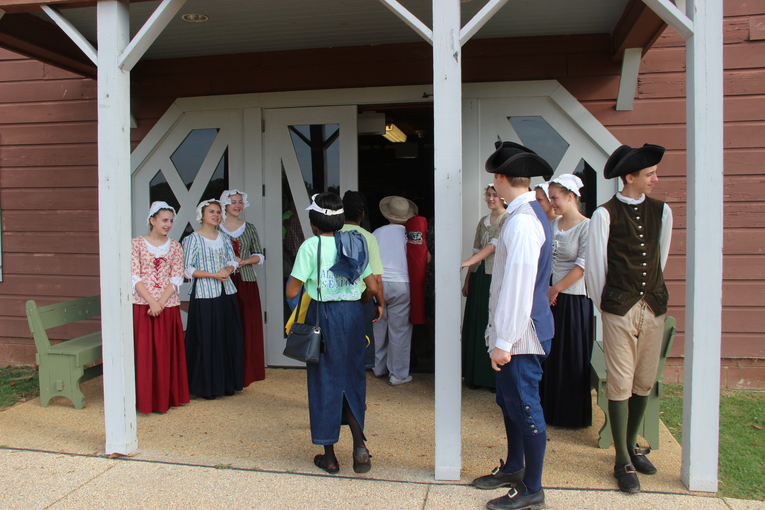 Image of American Village Staff greating guests at the 2016 Senior Picnic