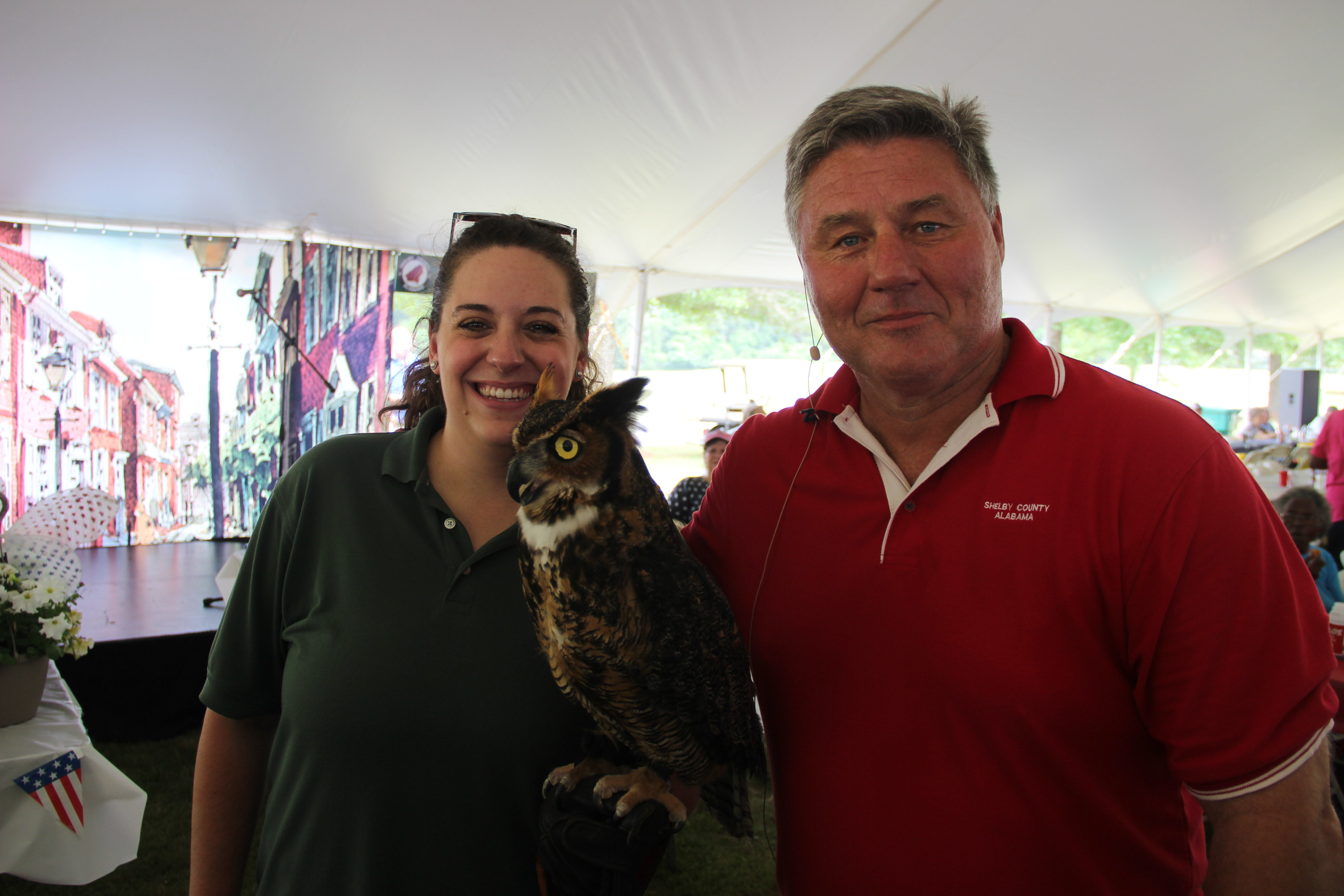Image of the county manager with owl and trainer